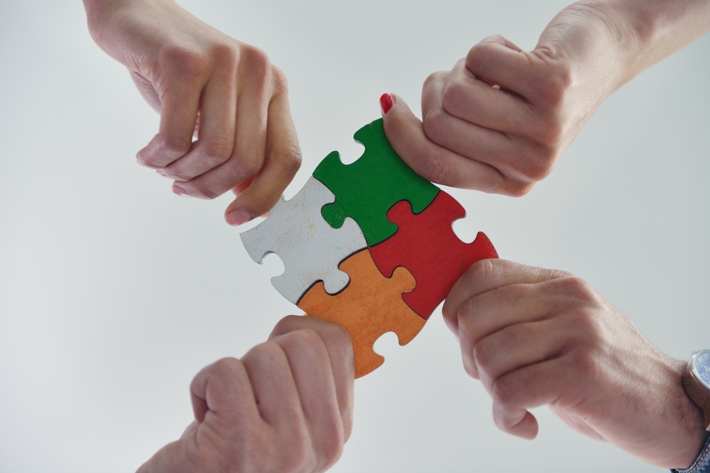 Group of business people assembling jigsaw puzzle and represent team support and help concept-1